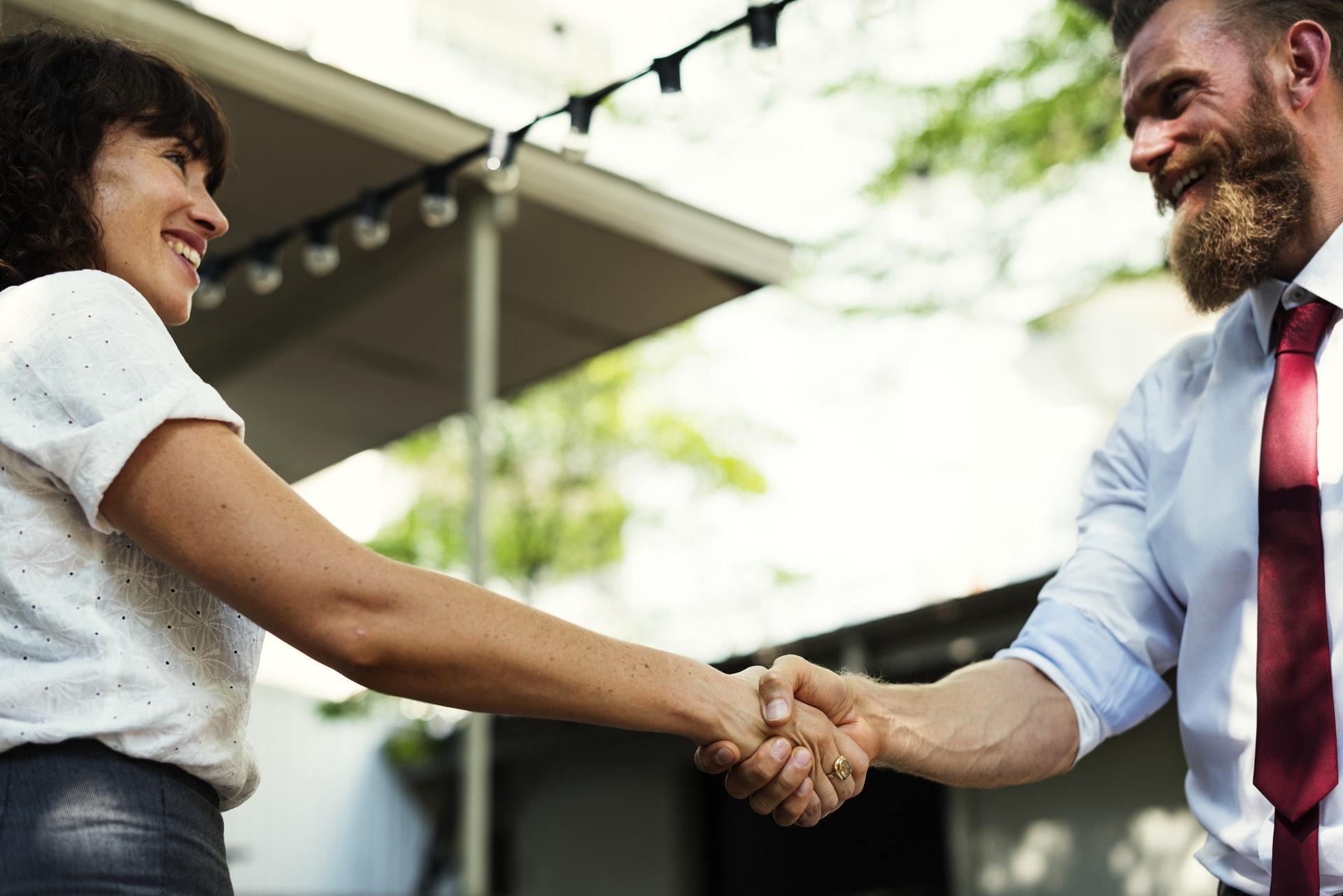 Man and woman shake hand